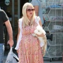 Tori Spelling Clutches On To A Stuffed Chicken