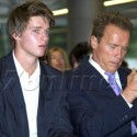 Arnold Schwarzenegger And Son Patrick Have A Chat In Spain