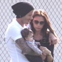 EXCLUSIVE! - David And Victoria Take Baby Harper To Soccer Game