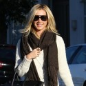 Ashley Tisdale Shows Off Her Stems In A Short Sweater Dress
