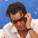 Charlie Sheen Has A Smoke At The Pool In Miami