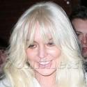 Lindsay Lohan Is White Hot At amFAR Event