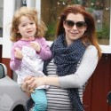 Alyson Hannigan Takes Her Bump For A Stroll