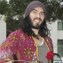 Russell Brand Throws Roses At Photographers!