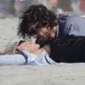 Sharon Stone Gets Frisky On The Beach With Younger Guy