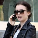 Lily Collins Chats On Her Cell While Strolling Through Beverly Hills