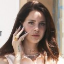 Lana Del Rey Is Glued To Her Cell Phone