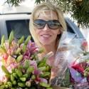 Camille Grammer Picks Up Flowers In Malibu