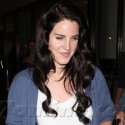 Lana Del Rey Lands At LAX With Her New Dark 'Do