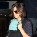 Maggie Gyllenhaal And Family Arrive At LAX
