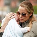 Elizabeth Berkley Hangs On Tight To Baby Sky