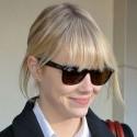 Emma Stone Lands At LAX