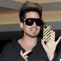 Adam Lambert Waves At Fans At LAX