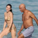 Russell Simmons And Girlfriend Frolick In The Ocean In Miami