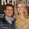 Tom Cruise And Rosamund Pike Hit The Blue Carpet