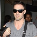 Brian Austin Green And Megan Fox Land At LAX With Their Baby