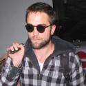 Rob Pattinson Carries His Bag At LAX