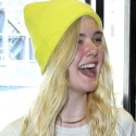 Elle Fanning Wears A Yellow Beanie To LAX