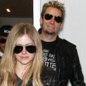 Avril Lavigne Arrives At LAX With Fiance Chad Kroeger