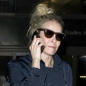 Chelsea Handler And Boyfriend Arrive At LAX