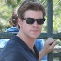 Liam Hemsworth Shows Off His Guns On Set