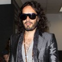 Russell Brand Looks Smug As He Lands In LAX
