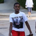Christian Combs And A Pal Ride Bikes Together