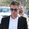 Robert Pattinson Wears A Suit On Set