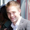 Rob Pattinson Smiles On The Set Of <em>Maps To The Stars</em>