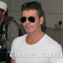 Simon Cowell And Pregnant Lauren Silverman Take Care Of Business In NYC