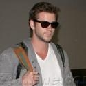 Liam Hemsworth Lands At LAX