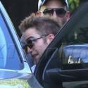 Robert Pattinson Ducks Into His Dodge Durango