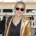 Sharon Stone Flashes Peace Sign At The Airport