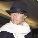 Pamela Anderson Covers Up Her New 'Do At LAX