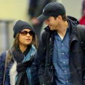 Mila Kunis And Ashton Kutcher Land At LAX