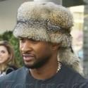 Usher Wears A Fur Hat During A Shopping Trip