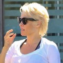 Pamela Anderson Can't Keep Her Shirt