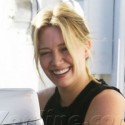 Hilary Duff Flirts With Her Trainer