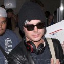 Zac Efron Lands At LAX