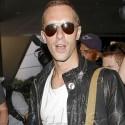 Chris Martin Arrives At LAX