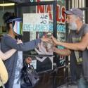 V. Stiviano Gives Homeless Man $40