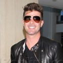 Robin Thicke Can't Stop Smiling Amid Threesome Controversy