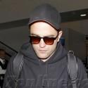 Robert Pattinson Makes His Way Through LAX