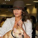 Chrissy Teigen And Her Dog Land At LAX
