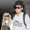 Evan Ross And Ashlee Simpson Land At LAX