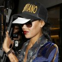 V. Stiviano Covers Her Face After Alleged Assault