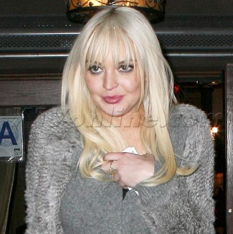 Lindsay Lohan saturday night live boot boots jeans sweater Lattanzi