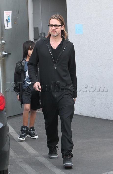 sunglasses Brad Pitt guitar  guitar center amp jumpsuit maddox