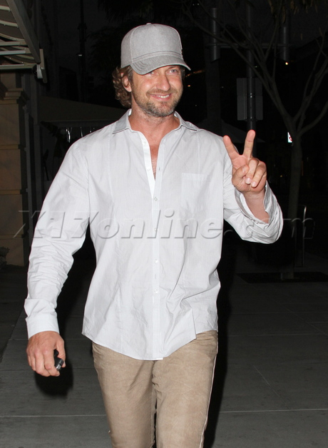 Gerard Butler hat button down shirt tan pants