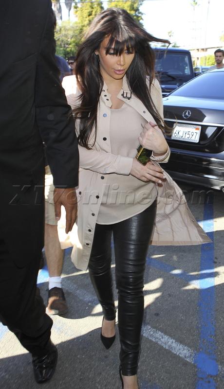 Kim Kardashian sherman oaks reality tv dress boobs pregnant leather